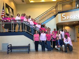 staff in pink on the stairs
