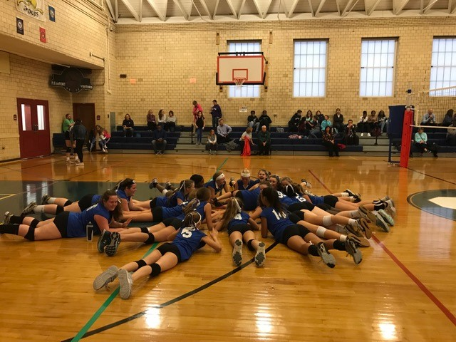 volleyball team celebrating
