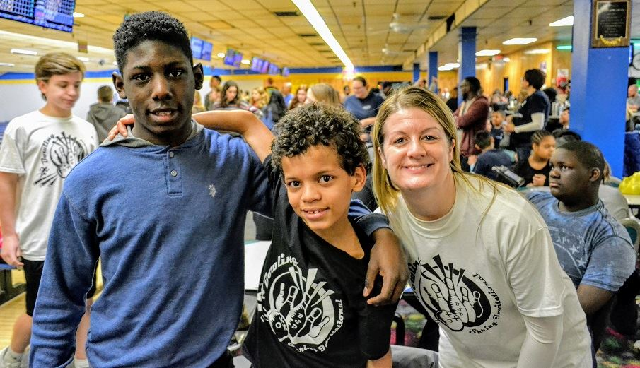 Teacher and students at bowling alley