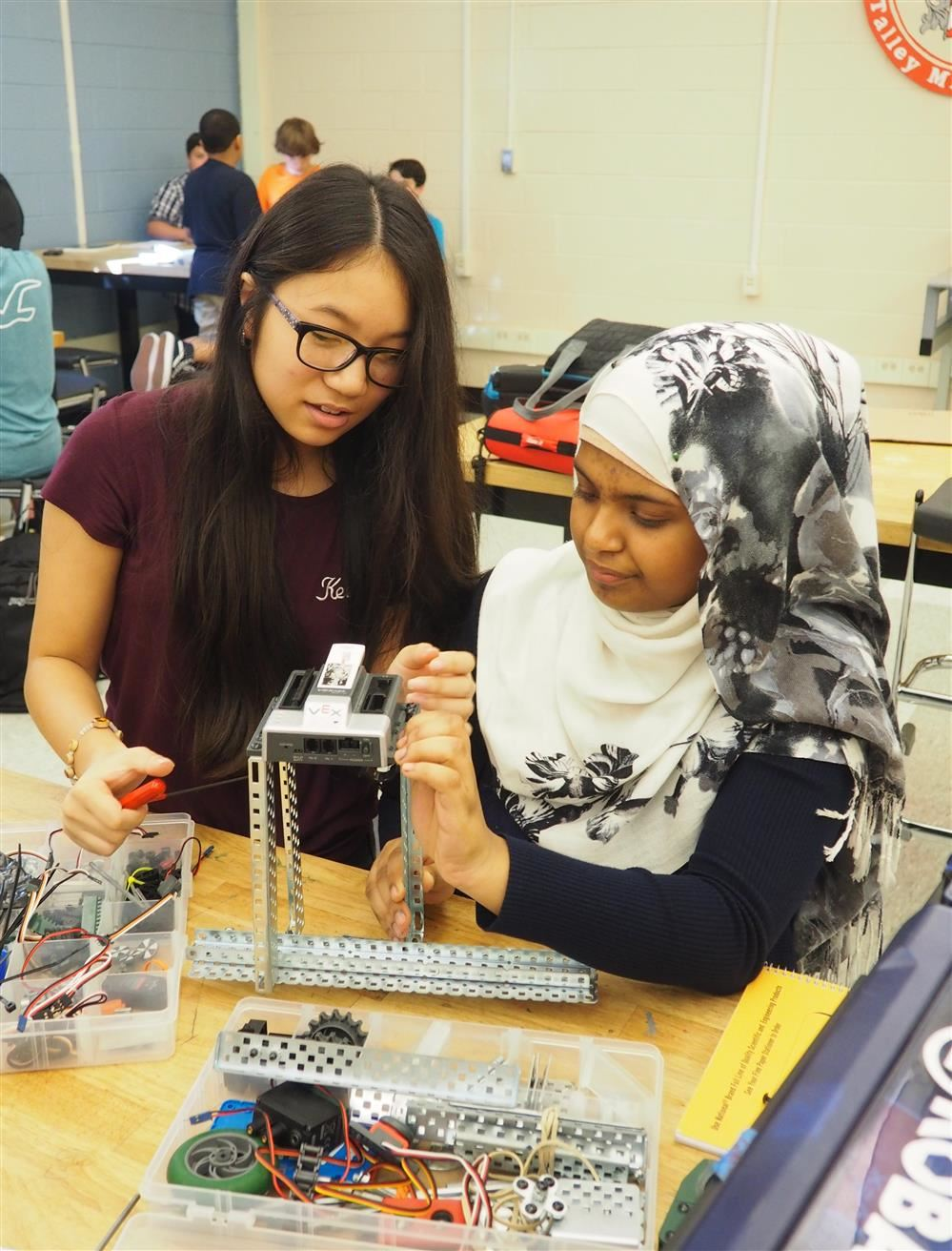 two girls working on a STEM project