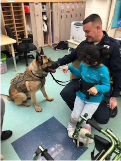 police officer showing special ed girl his police dog