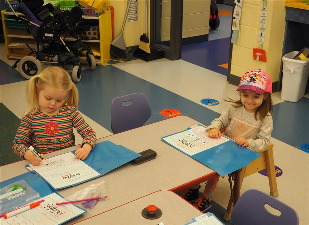 preschool students working at table