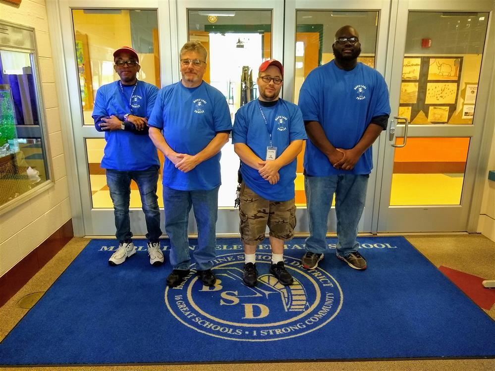 Custodial staff posing